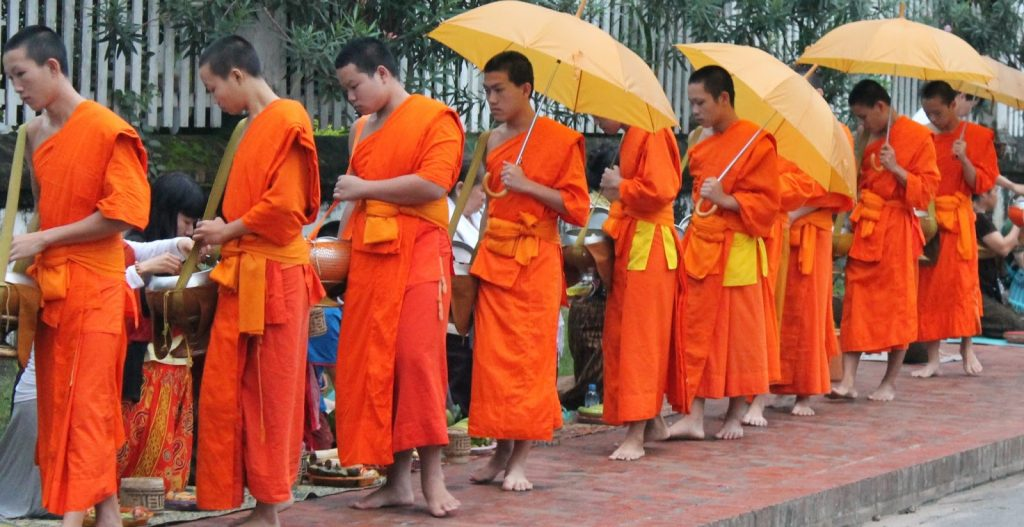 Why orange color is used in buddhism