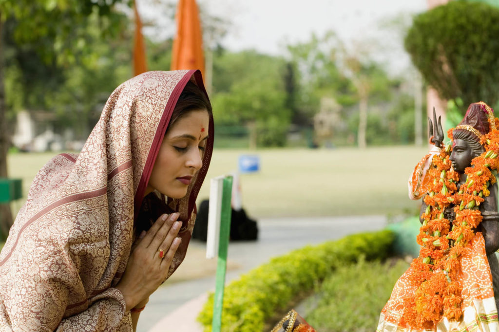 Young woman offering prayers